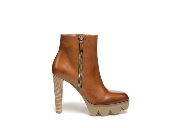Mi-bottes avec zip sur plateau cranté