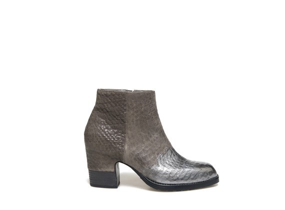 Ankle boot with metallic toe and partially shell shaped heel