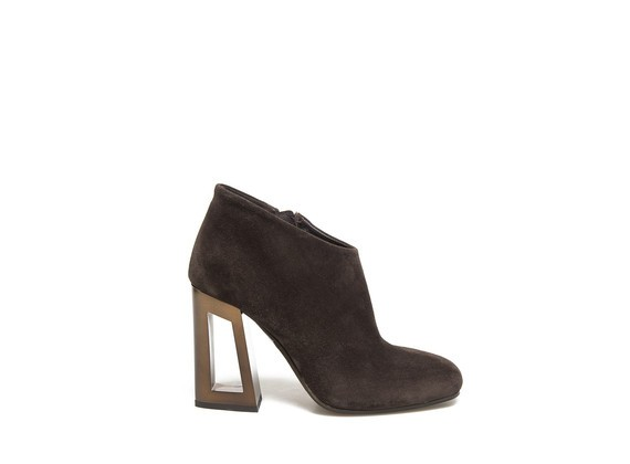 Ankle boots with perforated metallic heel