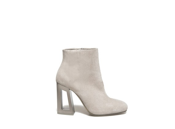 Suede ankle boot with metallic perforated heel