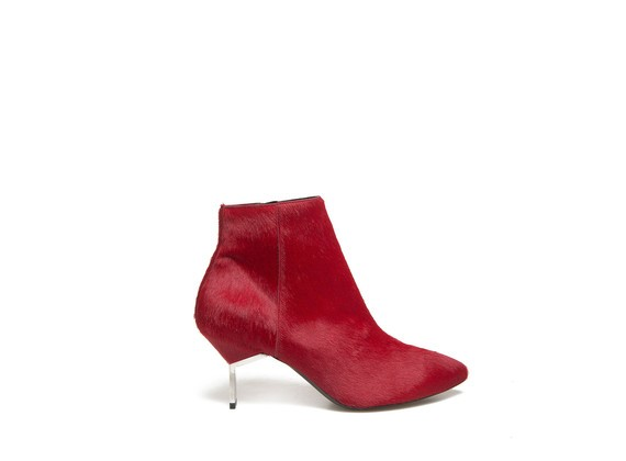 Low boot in red pony skin effect leather and steel heel
