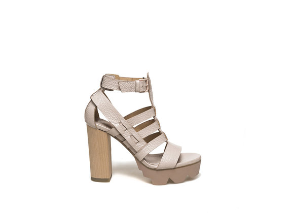 Light dusty pink caged sandal with wooden heel