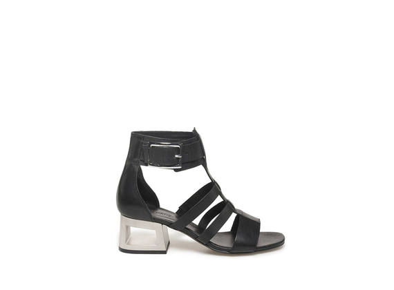 Caged sandal with steel-colouedr perforated heel