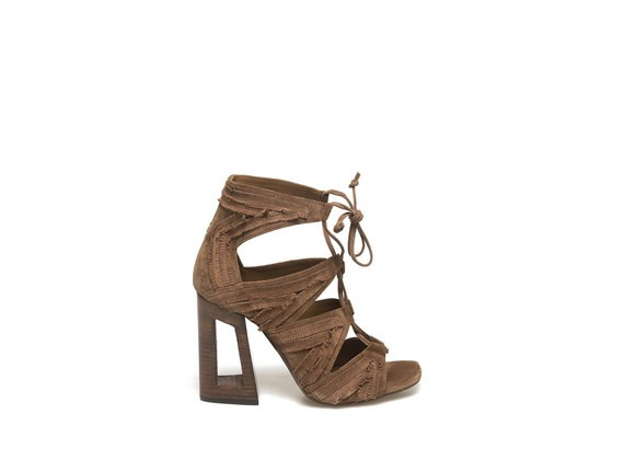Sandal with cross over lace and perforated gold heel