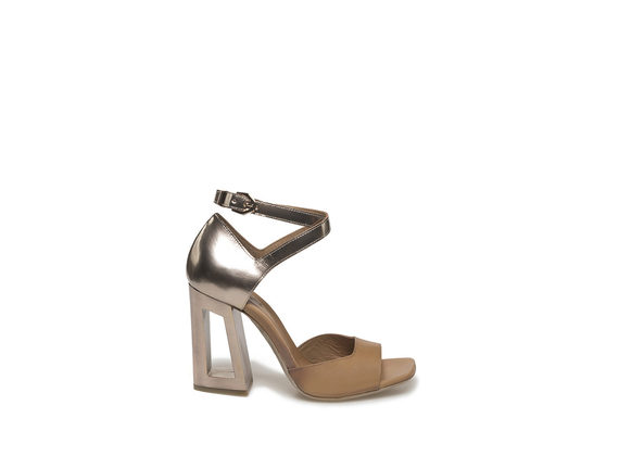 Sandal with golden, perforated heel
