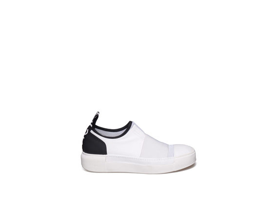White slip-on with black heel