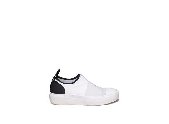White slip-on with black heel