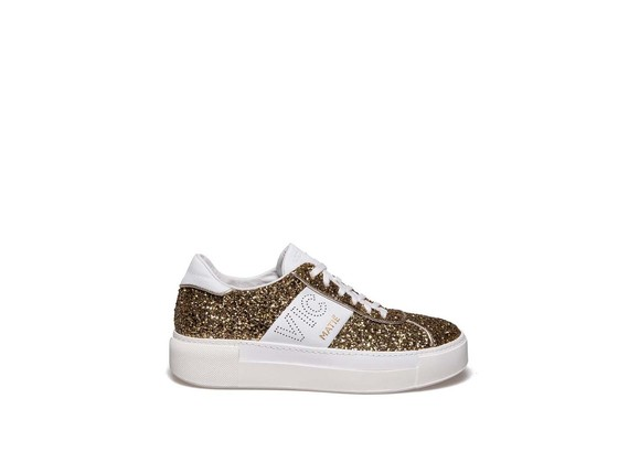 Lace up shoe in glitter and burnished gold leather