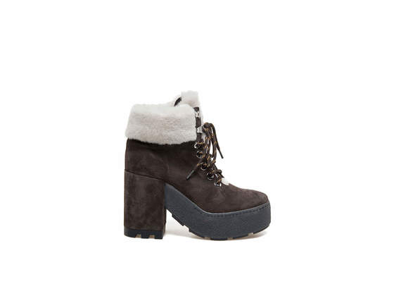Brown suede lace-up booties with sheepskin