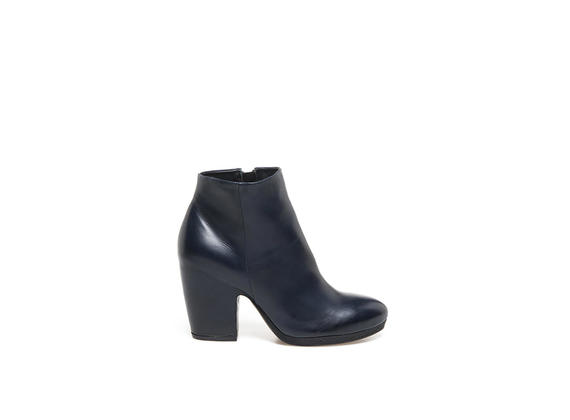 Midnight blue leather ankle boot with shell-shaped heel