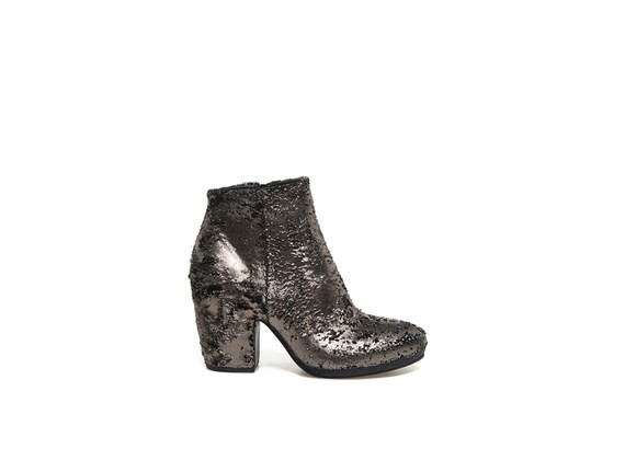 Metallic bronze-coloured carved leather ankle boots