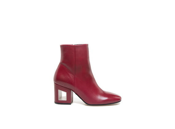 Red leather ankle boots with perforated heel