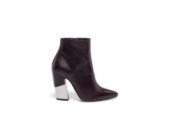 Burgundy pointed toe ankle boots with partially-covered metal shell-shaped heel