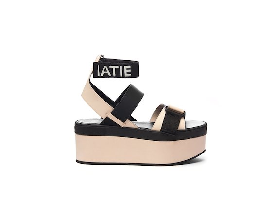 Sandal with a dusty pink wedge, Velcro and ankle strap with logo
