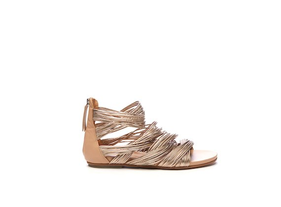 Flat sandal with nude-coloured mini braids