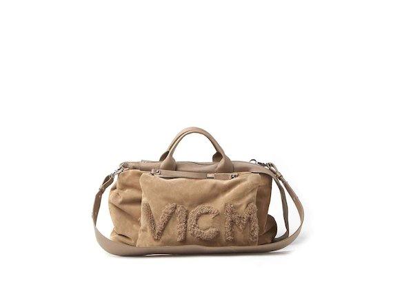 Lena<br />bowler bag and clutch with sheepskin logo