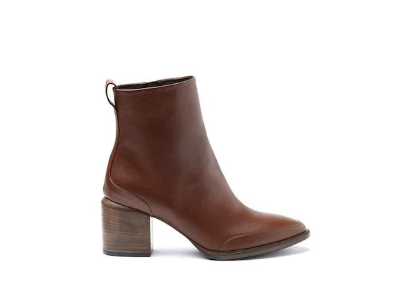 Cognac-coloured ankle boots with leather-covered heel