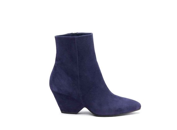 Navy blue suede heeled ankle boots with shell-shaped heel