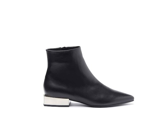 Black leather heeled ankle boots with metallic block heel
