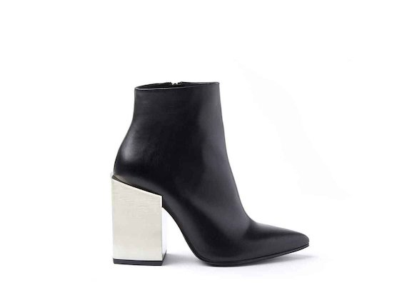 Black leather heeled ankle boots with high metallic block heel