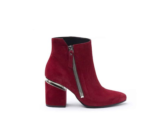 Red suede heeled ankle boots with maxi zip and suspended heel