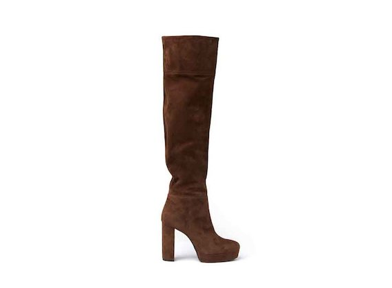 Cognac-coloured leather thigh-high stove pipe boots with leather-covered platform and heel