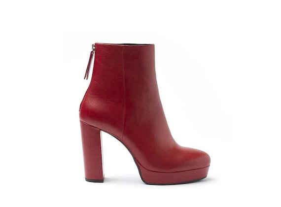Red leather heeled ankle boots with leather-covered platform and heel