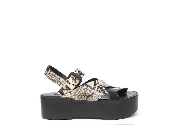 Sandal with rock snakeskin-effect braided bands
