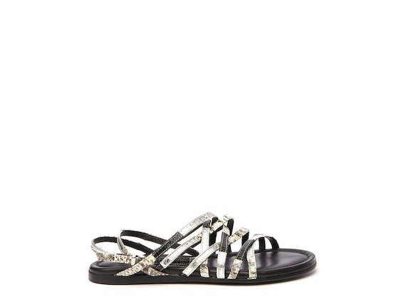 Flat sandal with thin snakeskin cross-over bands