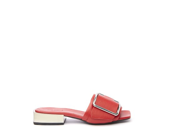 Red flat sandal with metal heel and buckle