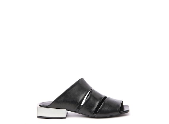 Slip-ons with metal heel and black asymmetric bands