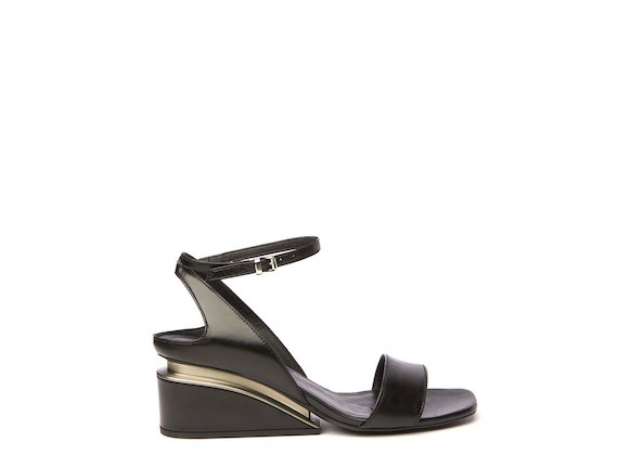 Black sandal with suspended heel