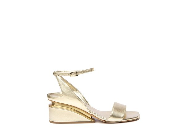 Gold sandal with suspended heel