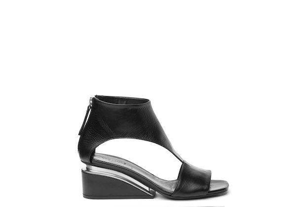 Sandal with ankle strap and suspended heel