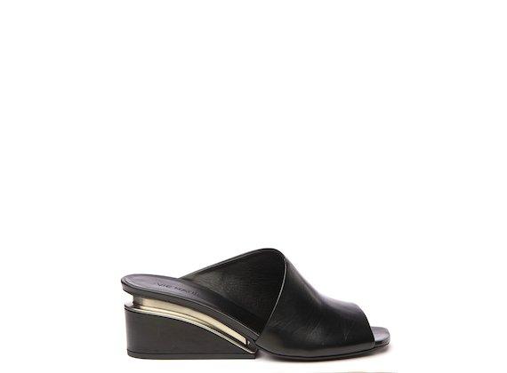 Black asymmetric slip-on shoe with suspended heel