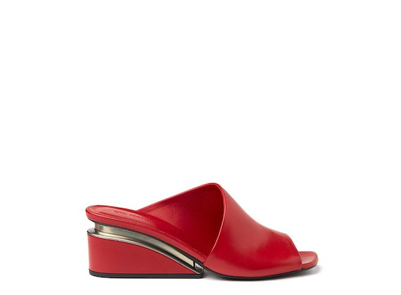Red asymmetric slip-on shoe with suspended heel