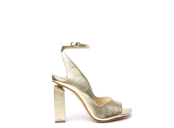 Gold peep-toe slingback shoe with suspended heel