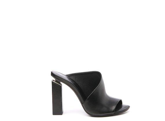 Black high asymmetric mule with suspended heel