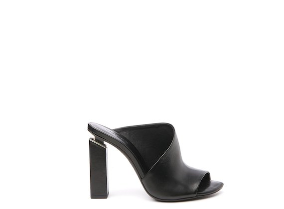 Black high asymmetric mule with suspended heel