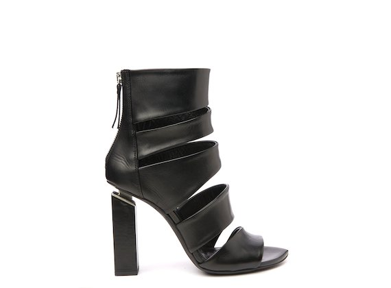 Asymmetric peep-toe ankle boot with suspended heel
