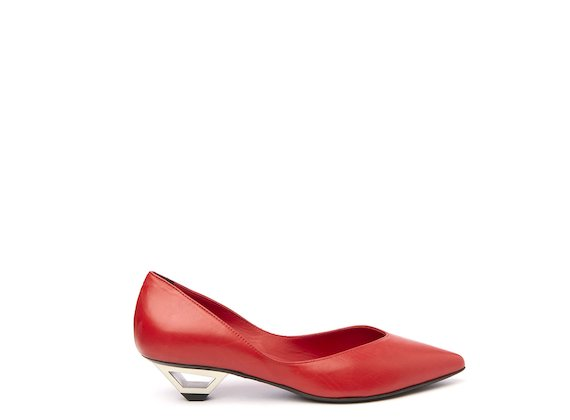 Red court shoe with hollow metal heel