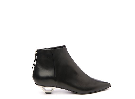 Black ankle boot with hollow metal heel