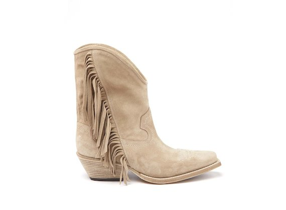 Beige Texan boot with fringes
