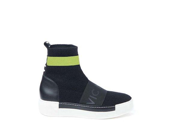 Sneakers style chaussette avec élastique et bande fluo