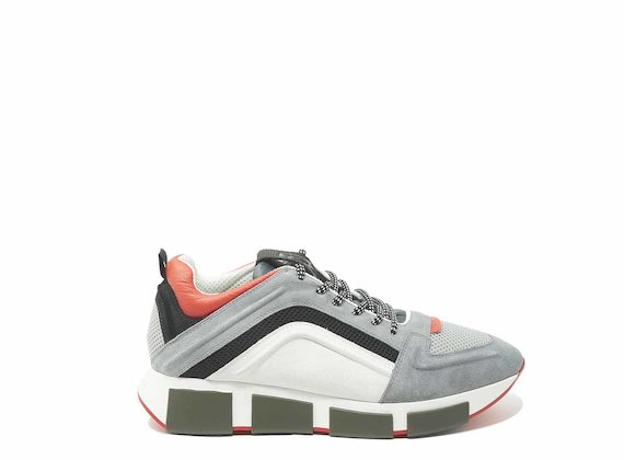 Grey/orange running shoes with raised 3D detail