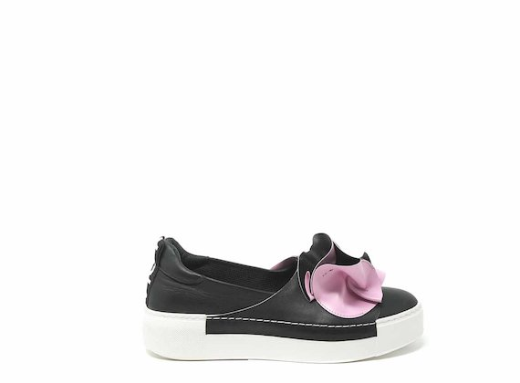 White and fuchsia slip-ons with large origami flower