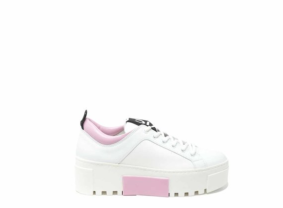 White trainers with spoiler and contrasting pink insert