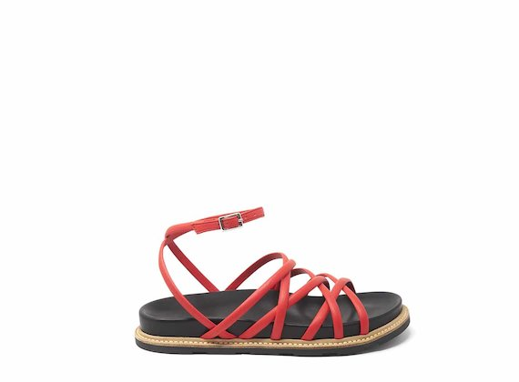Red sandals with criss-crossing strips