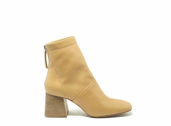 Tan ankle boots with flared heels