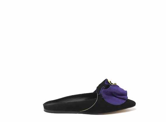 Black slip-ons with origami flowers